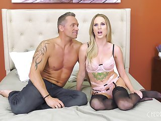 Tattooed blonde MILF Jenna Jones rides a fast cock in stockings