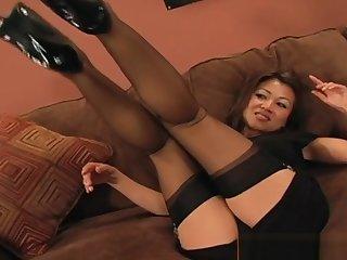 XXX Asian cutie spreads her toes thru her stockings
