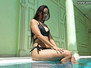 Beloved beauty Andriena De Luxe tickles her clit and swims in sexy similarly