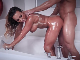 Oiled beauty fucks in extravagant modes before swallowing