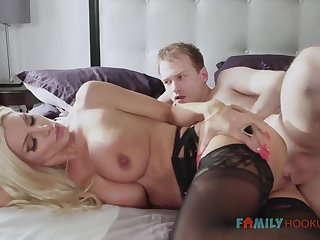 Sizzling blnde COUGAR is wearing softcore, dark-hued stocking to the fullest extent a finally having fuck-a-thon with her spouse's connect with